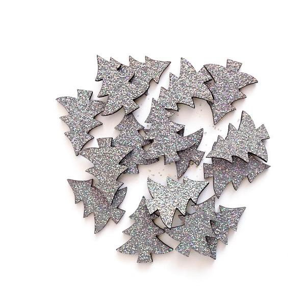 Kleine, dekorative Tannenbäume mit Glitzer in Silber für Weihnachten.