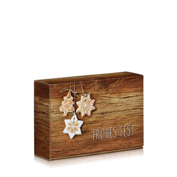 Geschenkbox für Weihnachten mit Lebkuchen auf Holz.